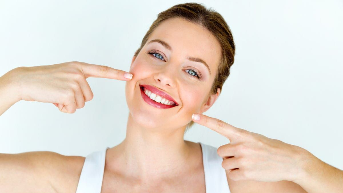 Woman smiling with beautiful teeth from dental sealants