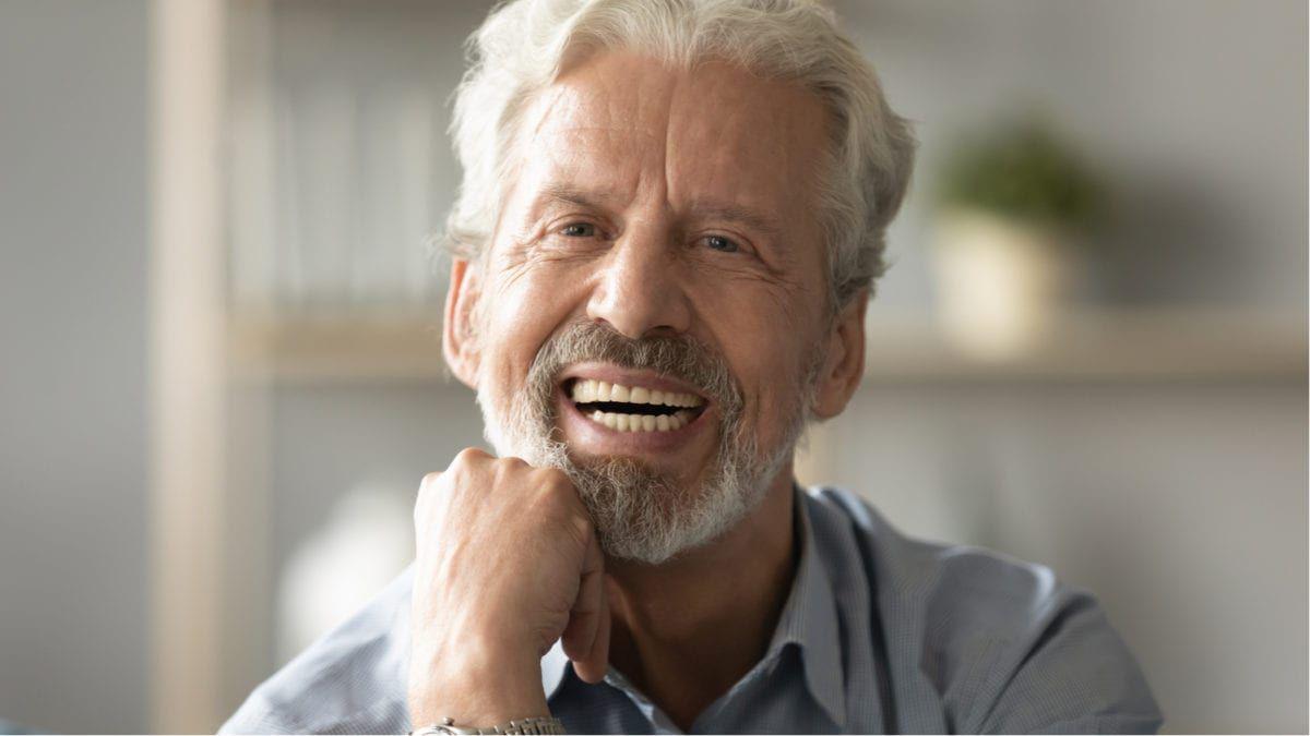 Elderly man smiling with dentures