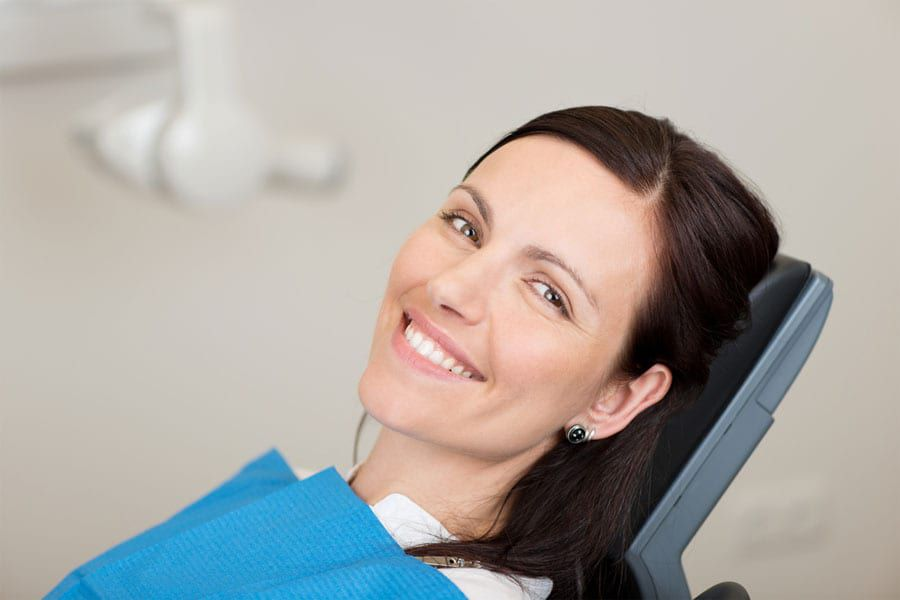 Female dental patient smiling