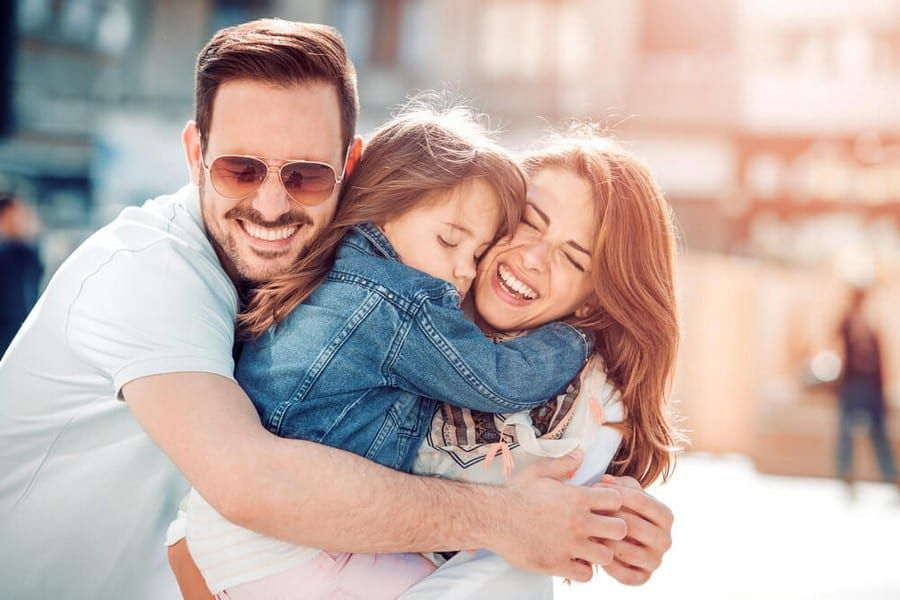 Couple smiling with their daughter