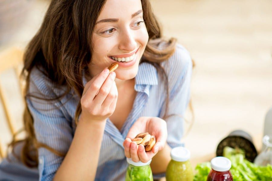 Young women smiling and eating