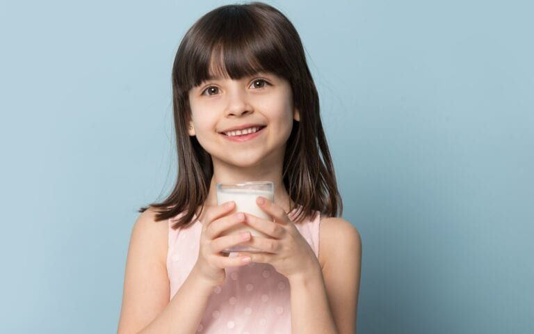 Child with glass of milk